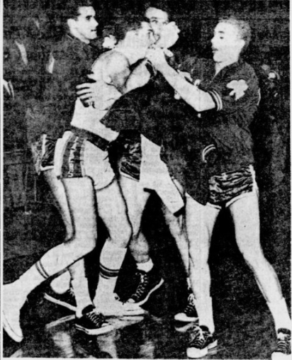 LaRusso being restrained by Celtics players (Reading Eagle)