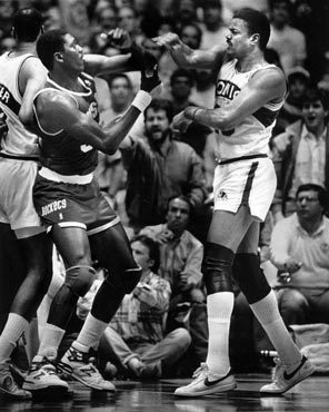 35-year old Maurice Lucas scuffles with a young Hakeem Olajuwon in 1987 (Seattle Times)