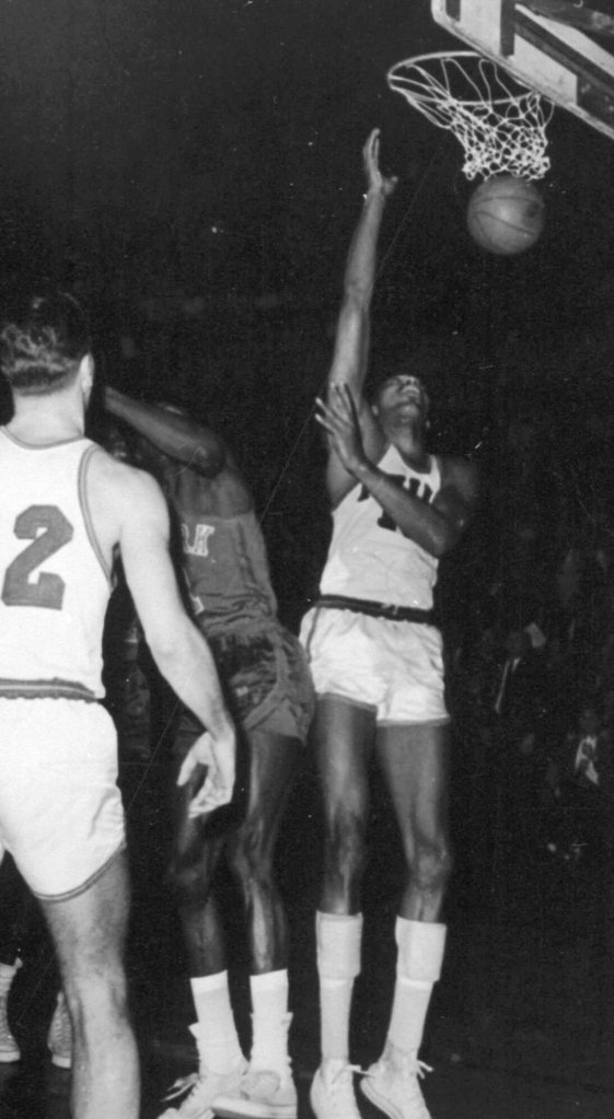 Philadelphia Warriors' Wilt Chamberlain, right, scores his 100th point, setting an NBA record, during a game against the New York Knicks in Hershey, Pa., March 3, 1962.  (AP Photo)