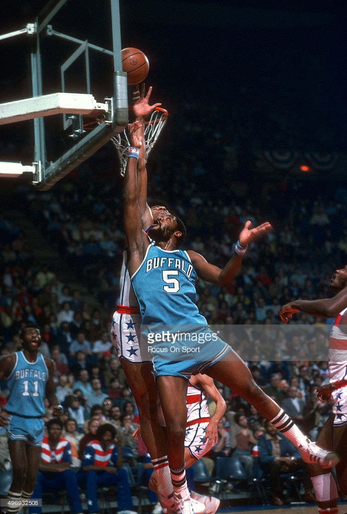 LANDOVER, MD - CIRCA 1975: Jim McMillian #5 of the Buffalo Braves shoots over Wes Unseld #41 of the Washington Bullets during an NBA basketball game circa 1975 at the Capital Centre in Landover, Maryland. McMillian played for the Braves from 1973-76. (Photo by Focus on Sport/Getty Images) *** Local Caption *** Jim McMillian; Wes Unseld
